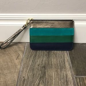 Fossil striped wristlet with gold hardware.